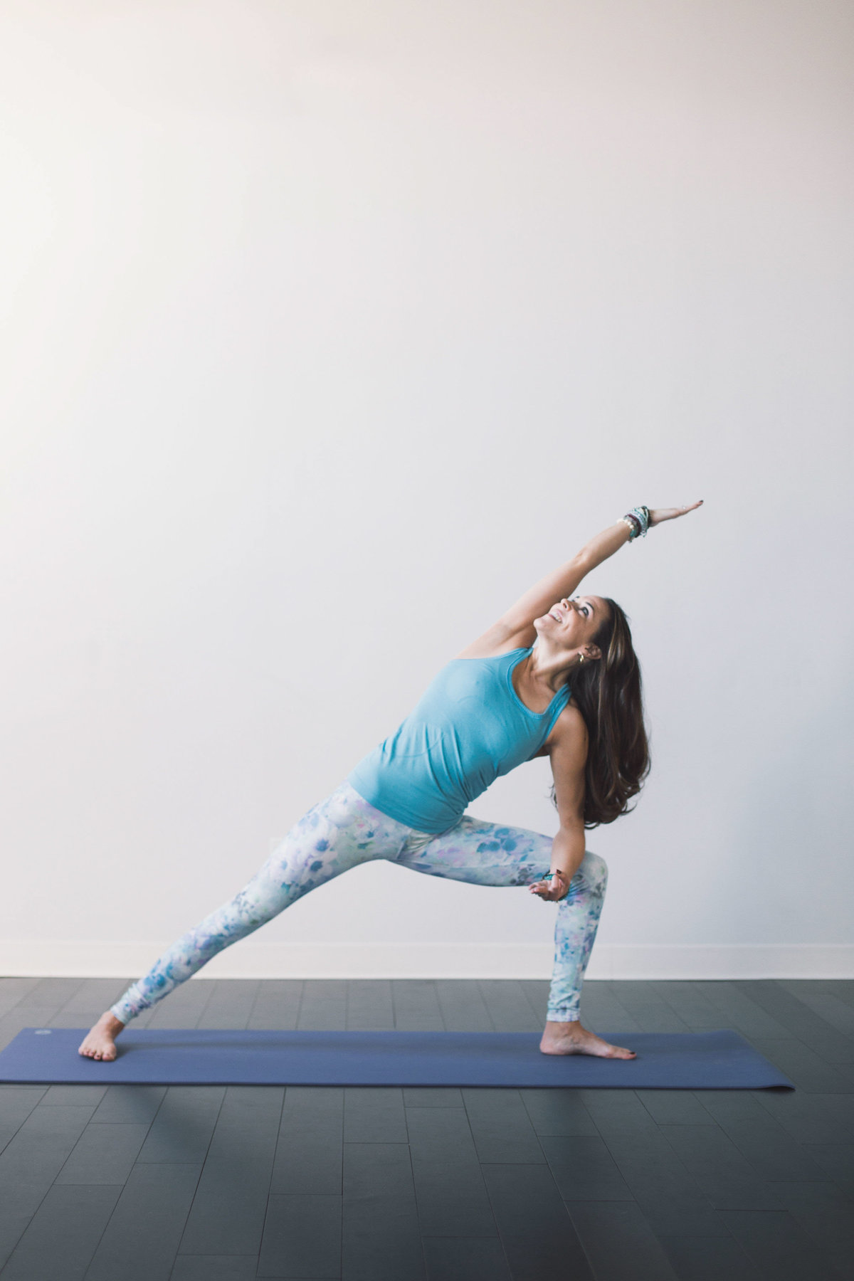 Girl strikes Triangle pose at Kompose Yoga studio