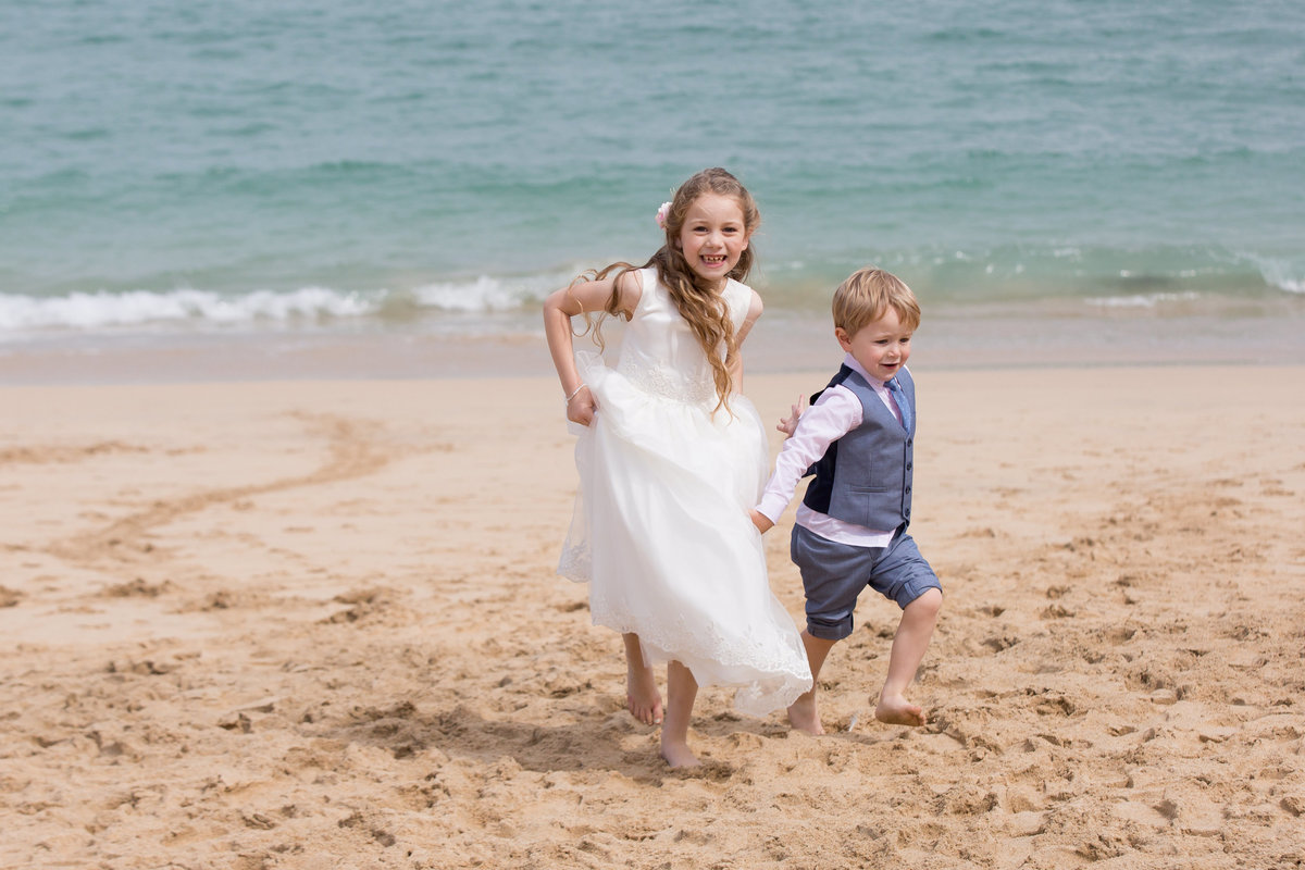 flower girl and page boy on the sand at carbis bay wedding cornwall