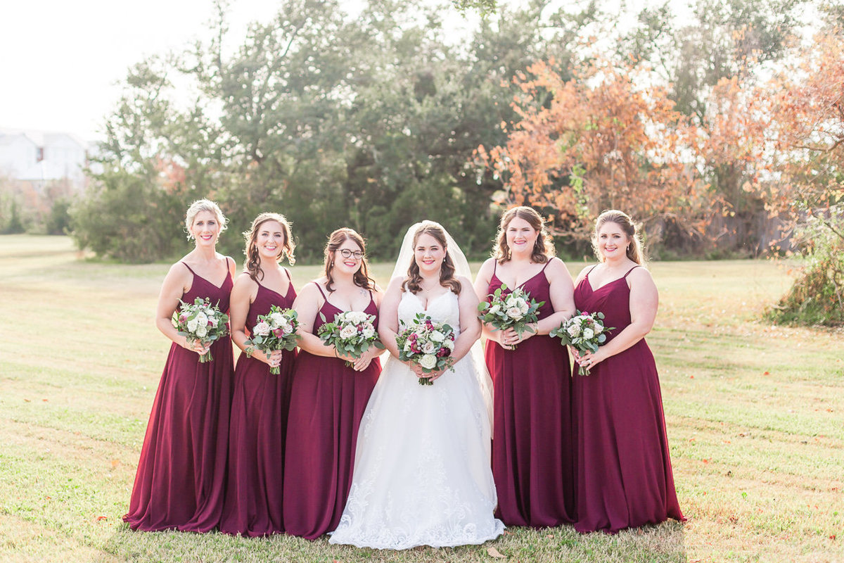 bride and bridesmaids portrait by Toni Goodie Photography
