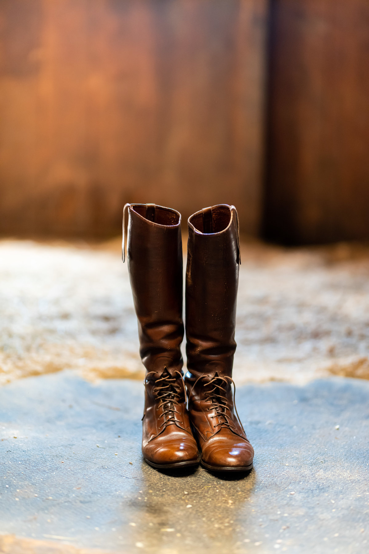 Riding boots photographed at stall, Richmond  wedding photographers