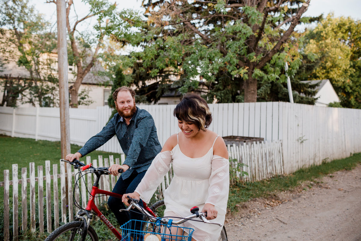 Couple biking down alley