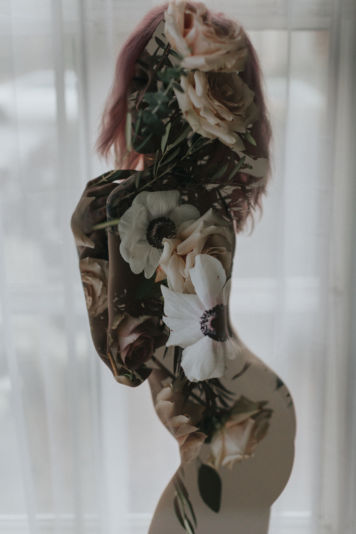 Double exposure floral boudoir pose