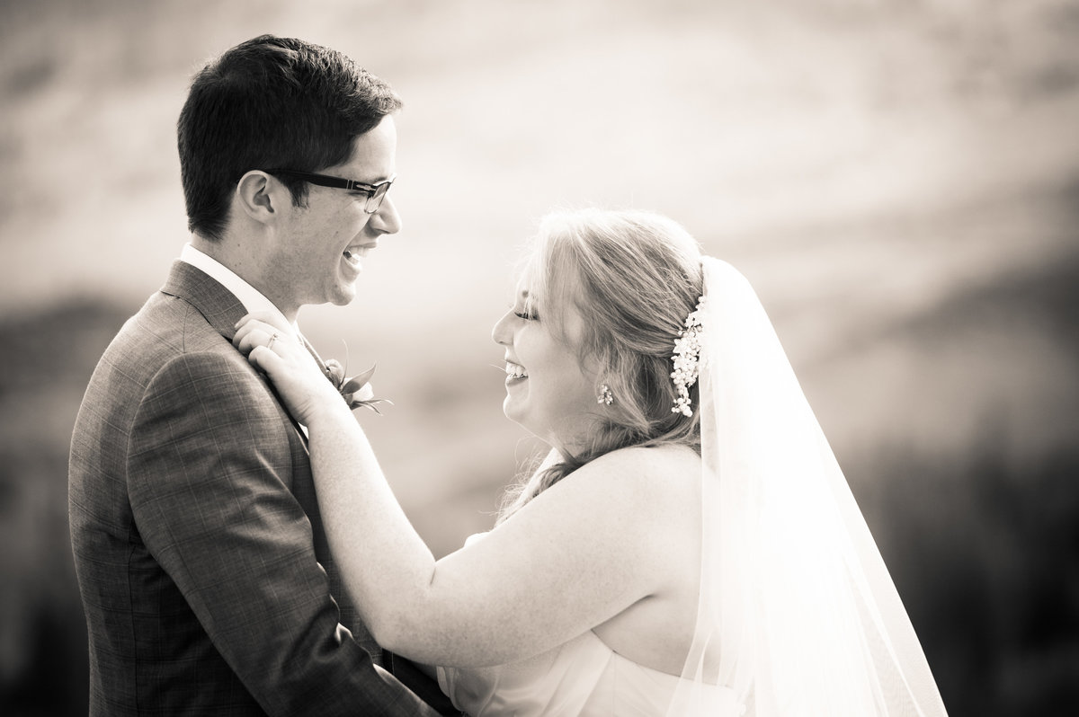 Bride and groom laughing after wedding ceremony, Park City, Utah.
