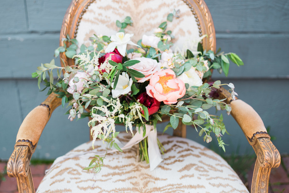 bridal bouquet on antique chair
