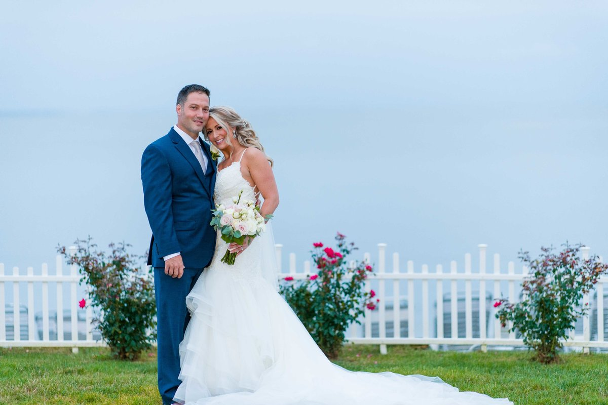 17 Bridal portrait in front of ocean at waters edge wedding