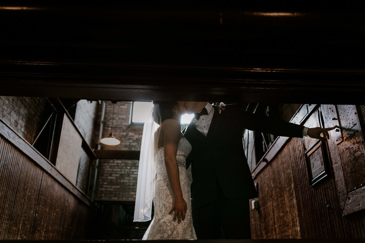 Bride and groom go up in service elevator towards their Biltwell Wedding in indianapolis
