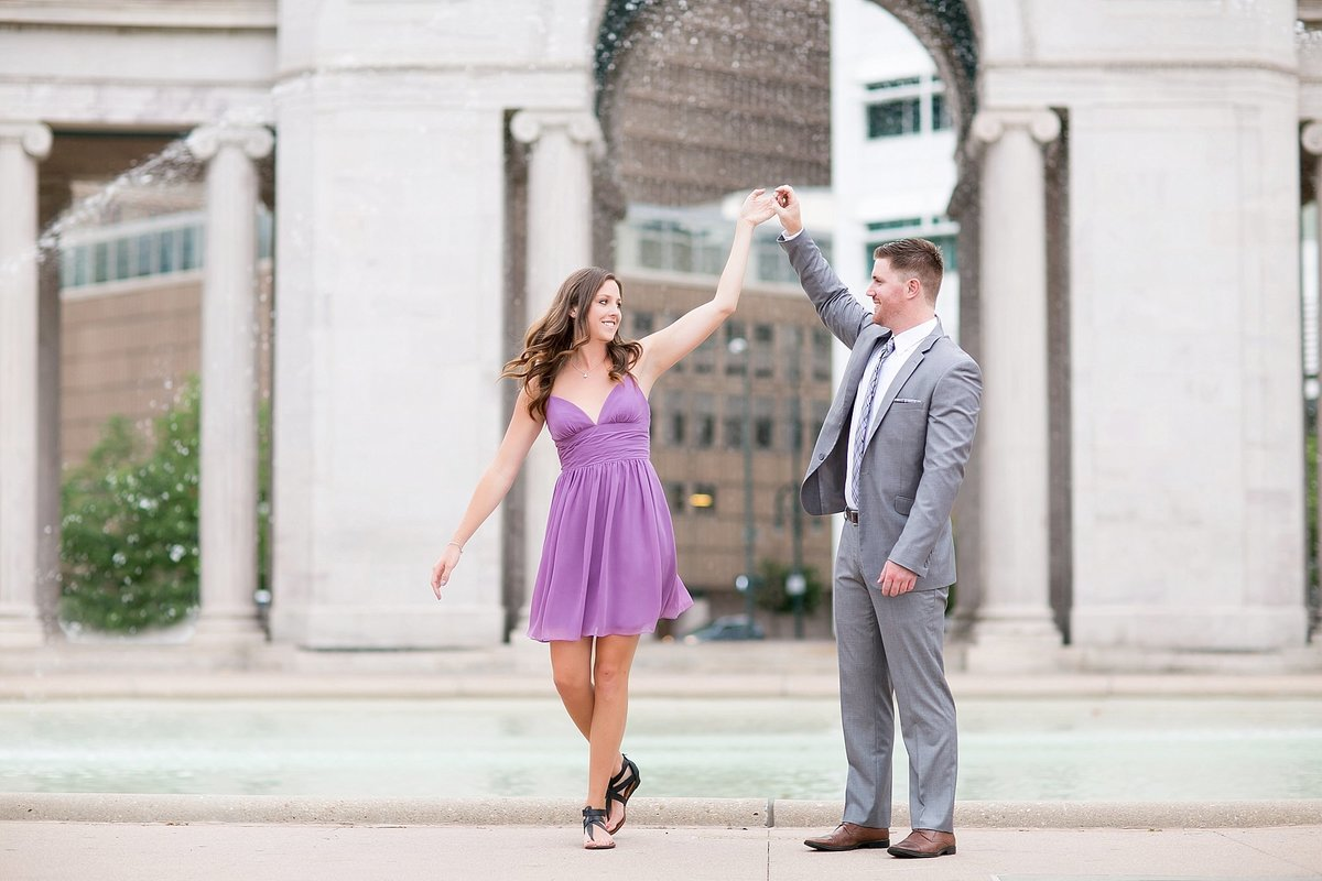 couple dancing in a park in Denver for their engagement photos