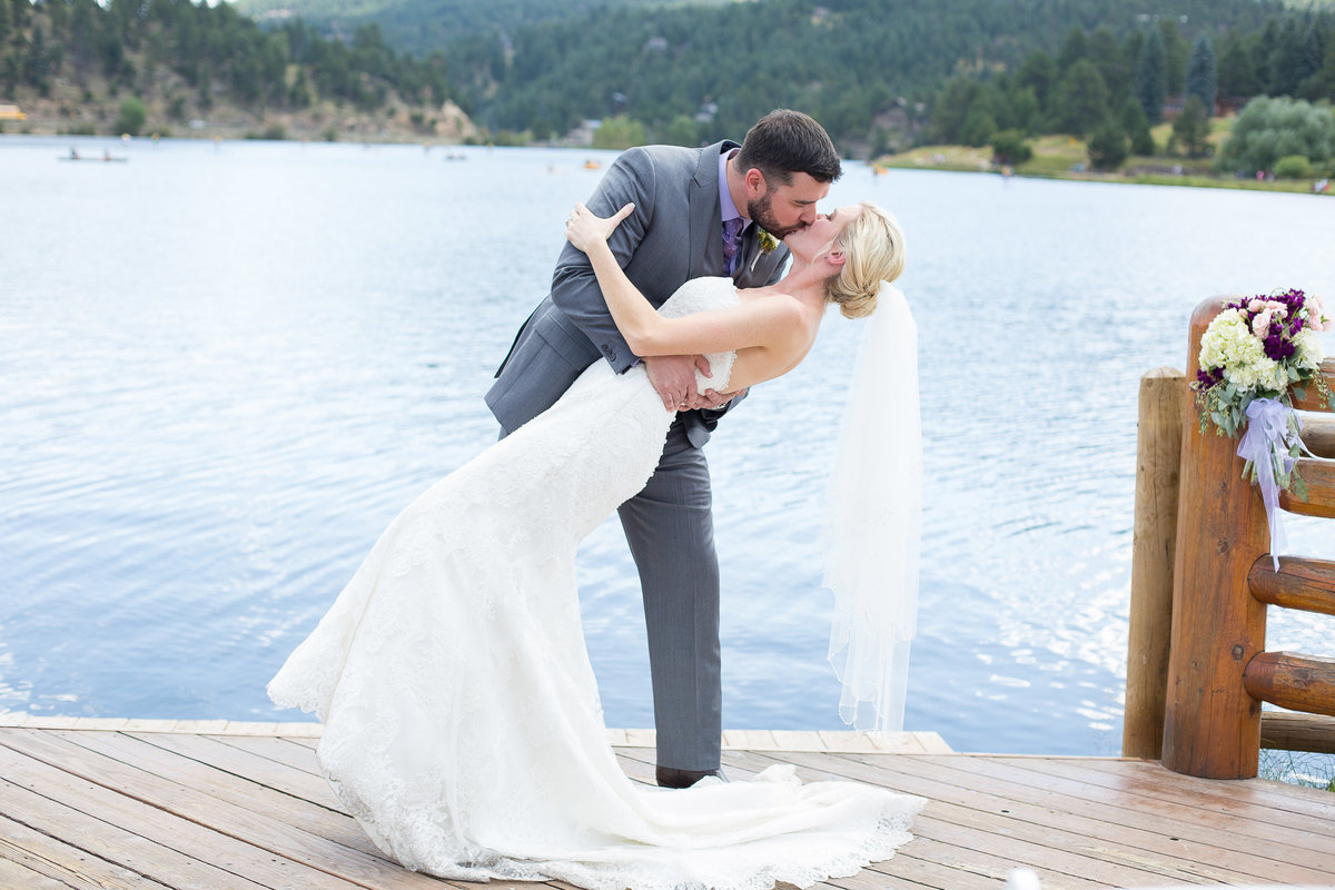 mountain lake wedding kiss
