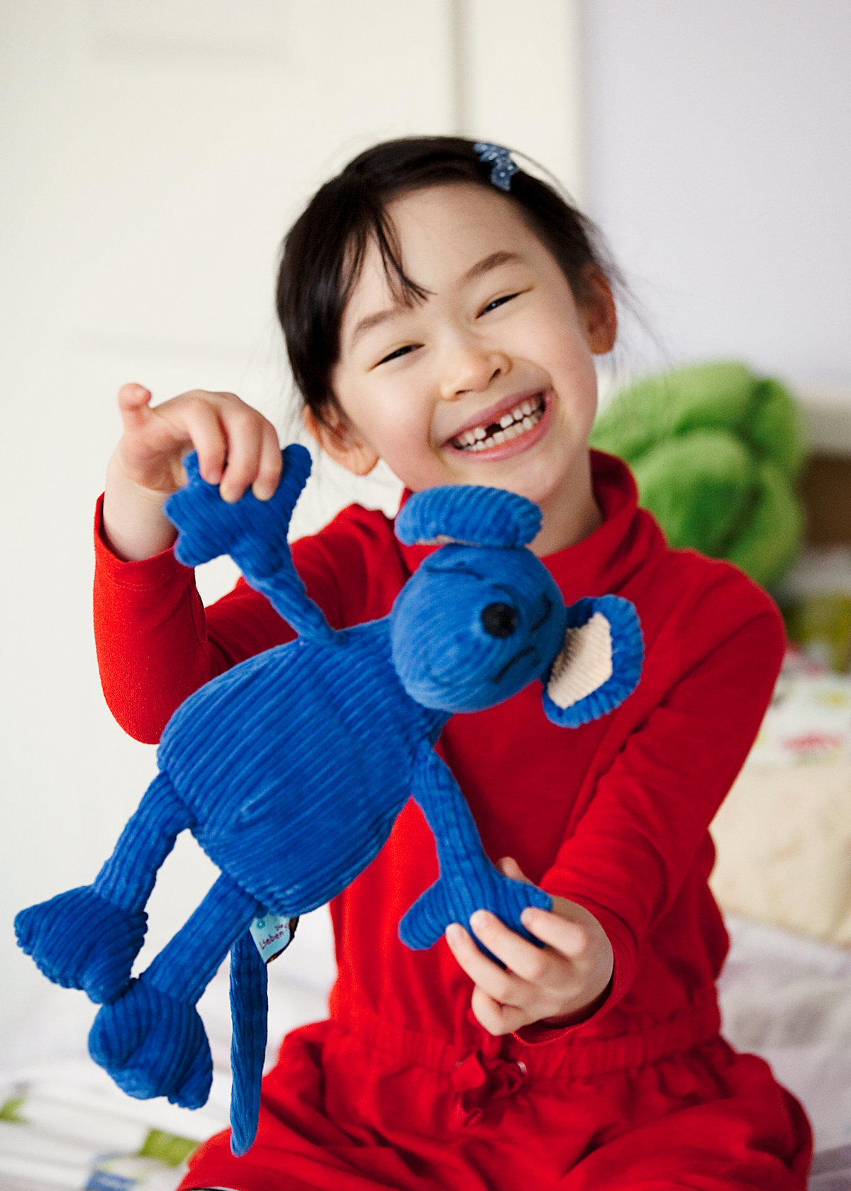 A girl is captured at home with her favorite stuffed animal  by CT family photographer Karissa Van Tassel