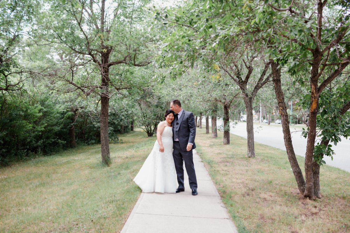 Couple goes for a walk in the heritage neighborhood in Regina