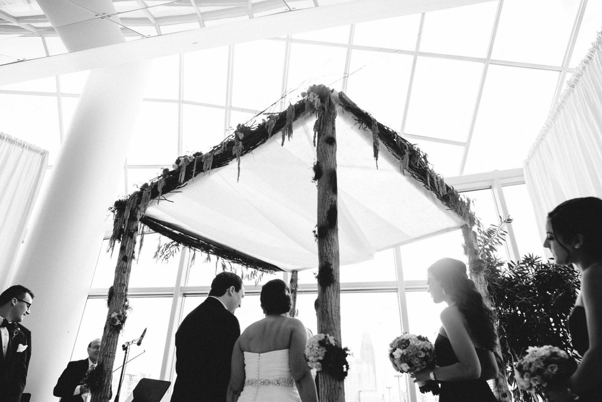 Chuppah decor by Carl Alan Florist for a Jewish Wedding at Cira Centre Philadelphia photo by Werth Photography