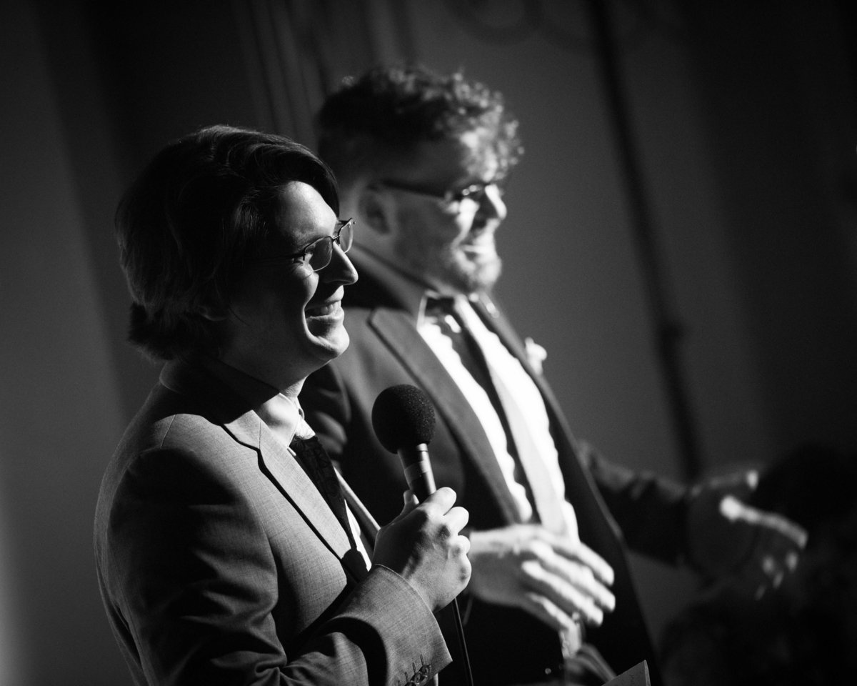 Hosts thank guests at radio drama launch party, Chicago.