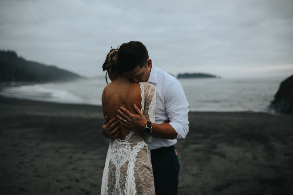 Bride and groom portrait of an elopement wedding in La Push  Washington on the moody beaches of Rialto Beach.