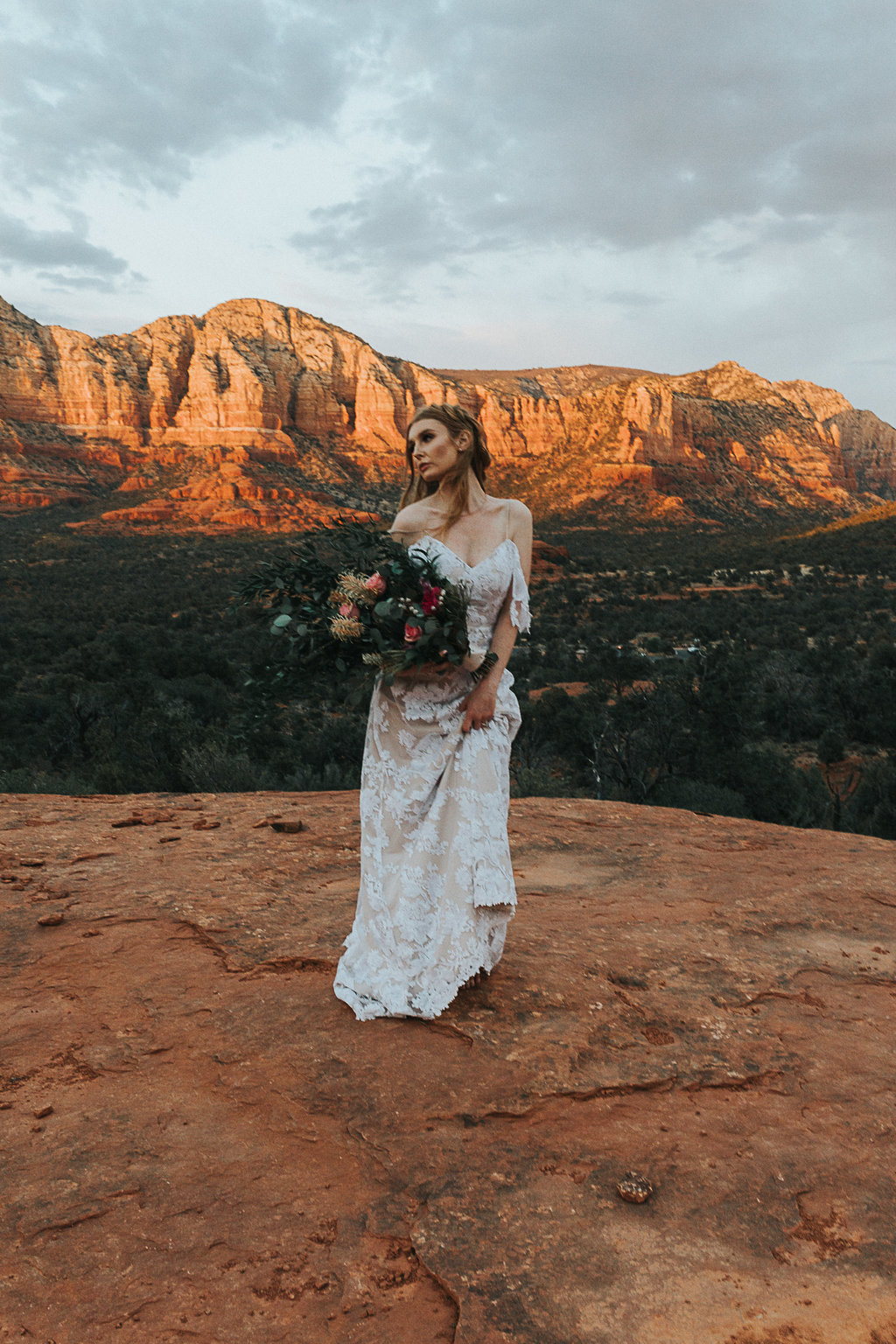 Lush florals adorn the background in this elopement in Sedona Arizona