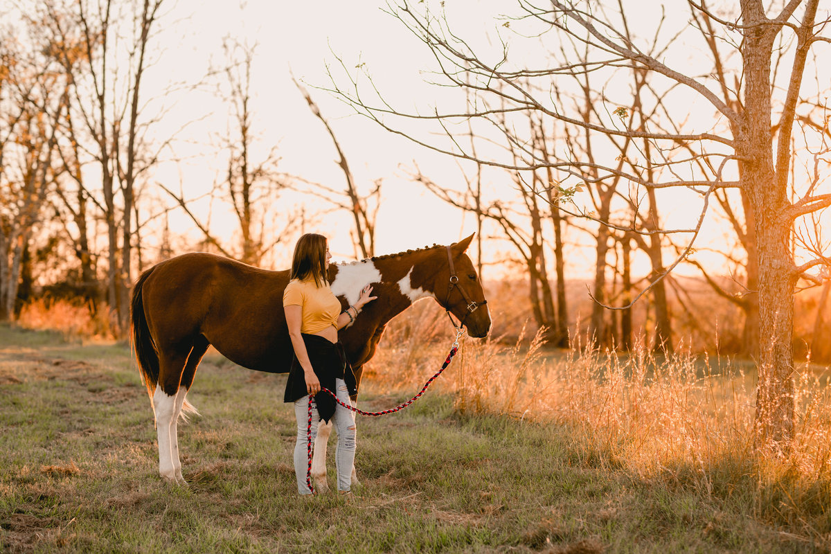 Sunset photo of girl with horse taken by Tallahassee professional photographer.
