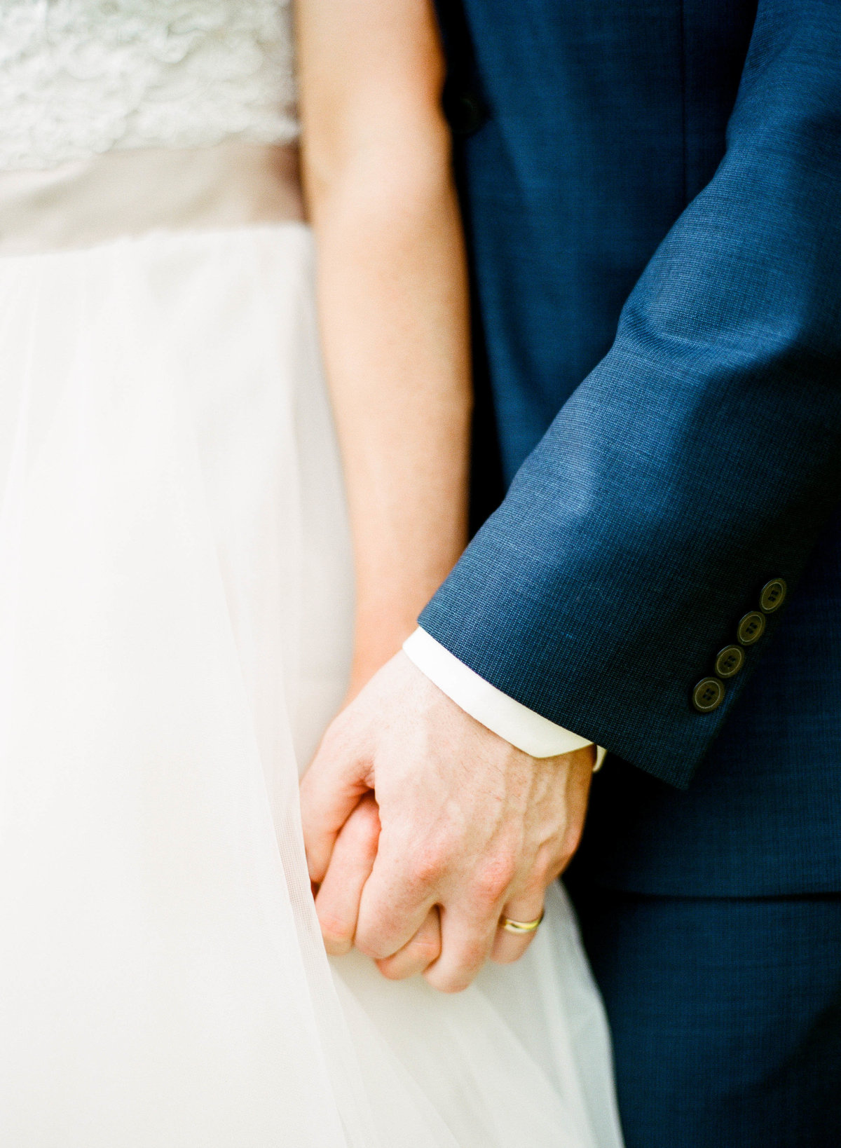 willowdale estate wedding couple holding hands