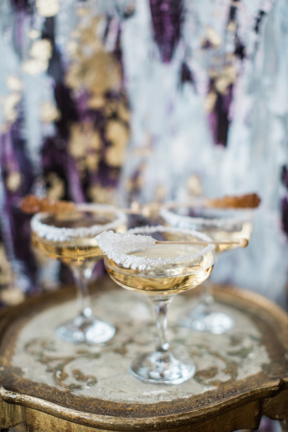 Signature drinks in front of custom abstract wedding backdrop By Brittany Branson