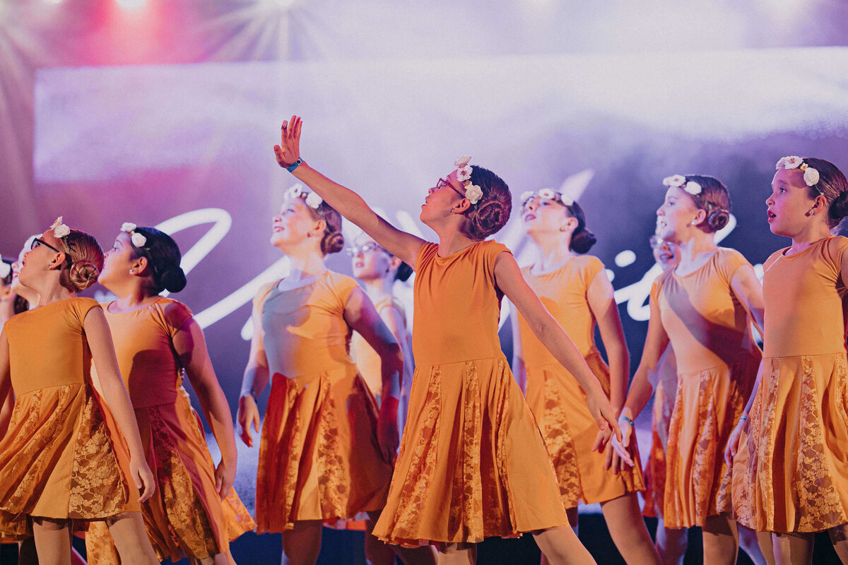 Dancers in yellow dress in Southlake showcase