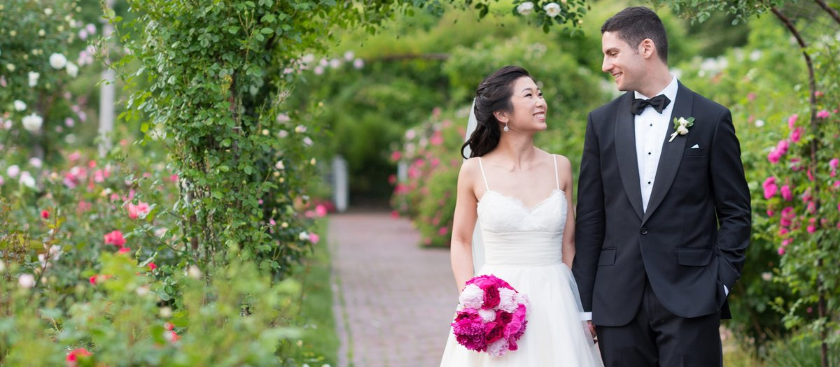 Bride and Groom walking in Rose Garden at Brooklyn Botanical Gardens photo
