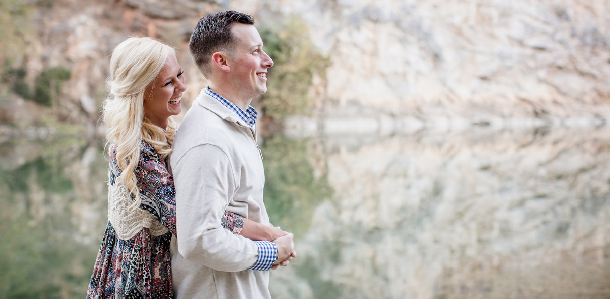 Standing in front of a huge rock wall at Meads Quarry by Knoxville Wedding Photographer, Amanda May Photos.