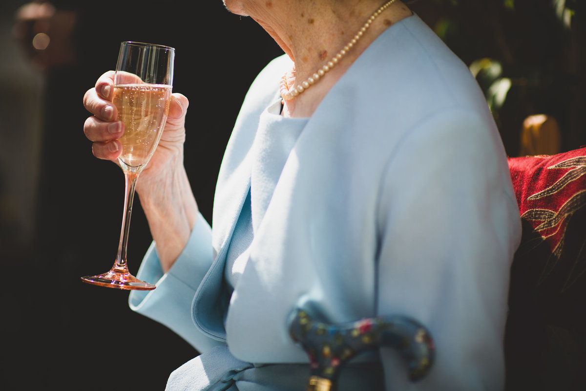 grandma holding a glass of champagne