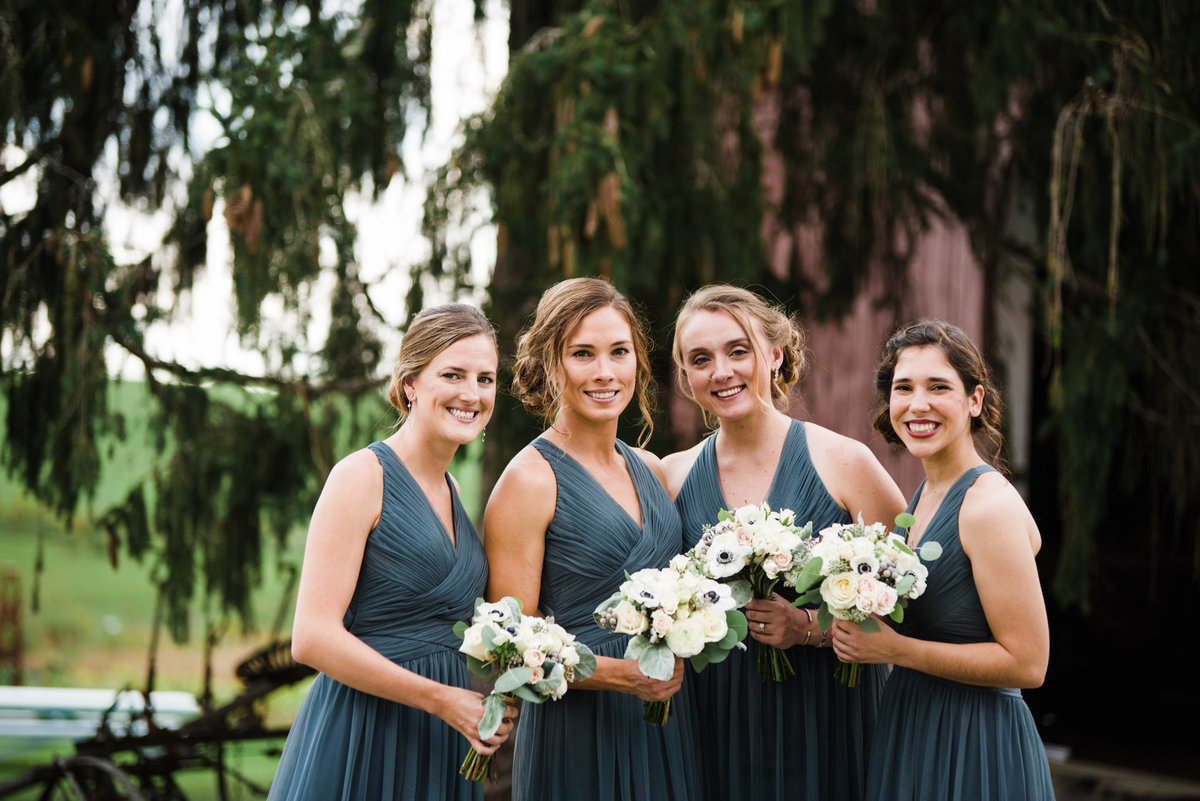 bridesmaids in gray BHLDN dresses, white anemone bouquets