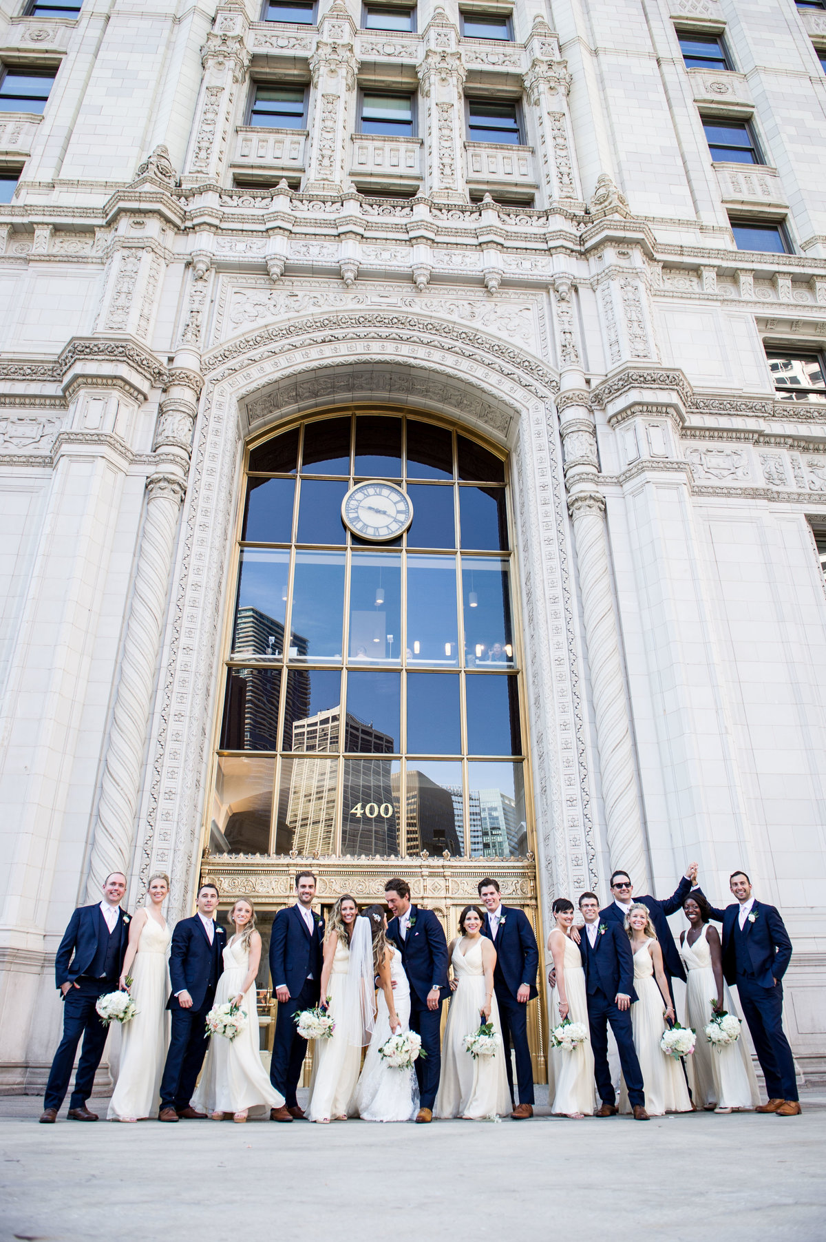 Briday party group shot, Wrigley building, Chicago wedding.