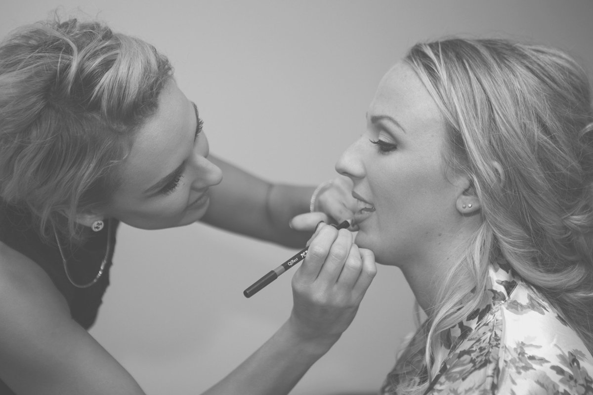 bride getting makeup donw
