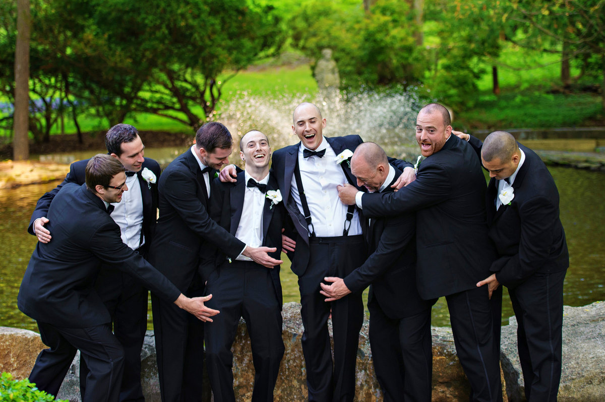 Groomsmen having fun with the groom at Holly Hedge Estate.