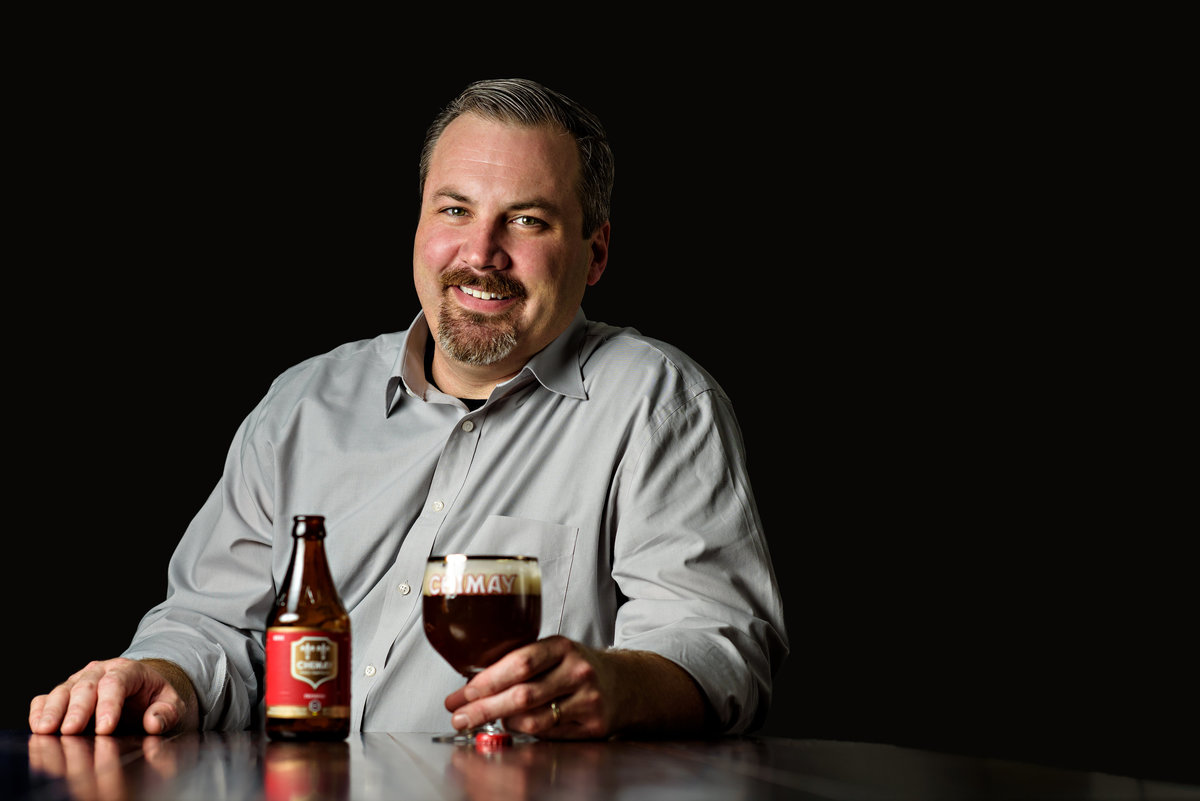 A head shot of a beer brewmaster.