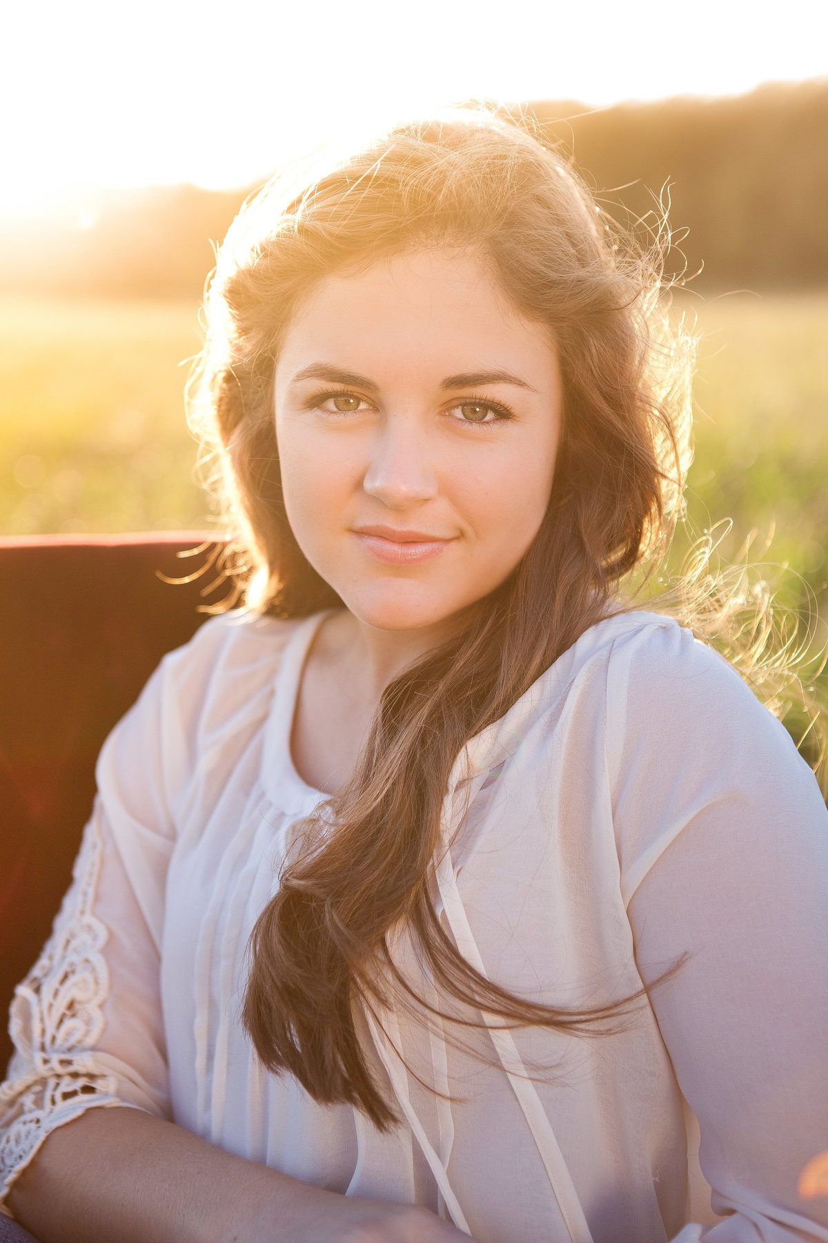 Senior girl portrait at sunset