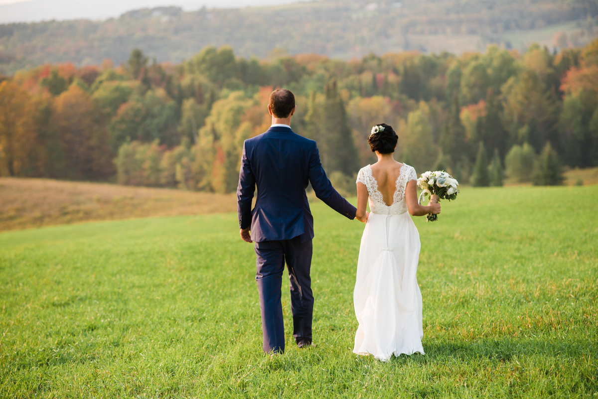 bride and groom with Vermont mountain view in fall