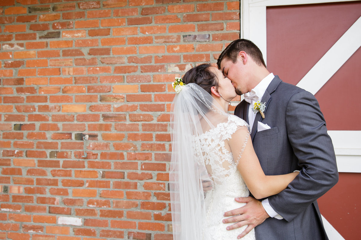 kiss-candid-moment-Colorado-garden-wedding