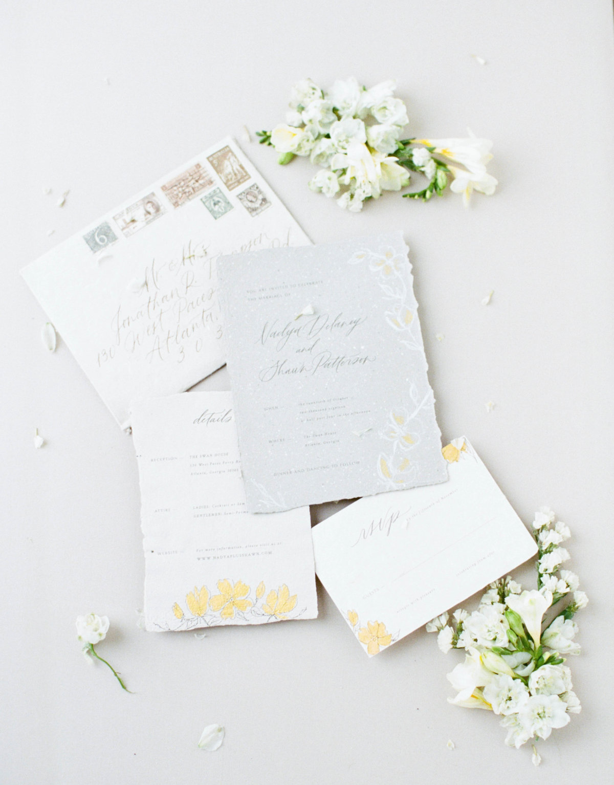 Fine art wedding invitations and paper goods with handmade details.