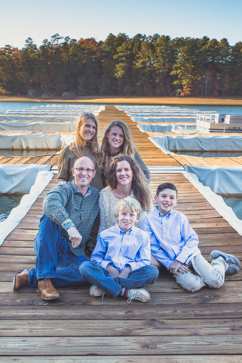 Family group photo  posing by lake and dock