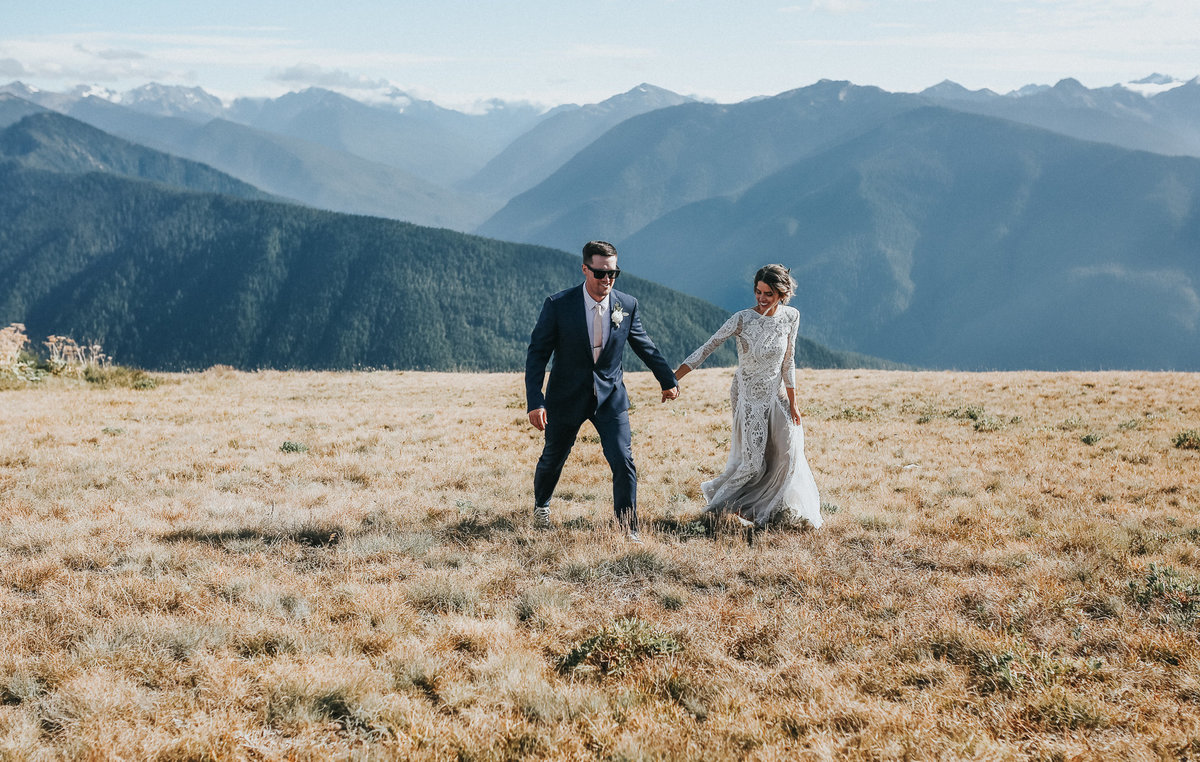 Hurricane Ridge elopement with bride and groom portrait with mountains in the background.