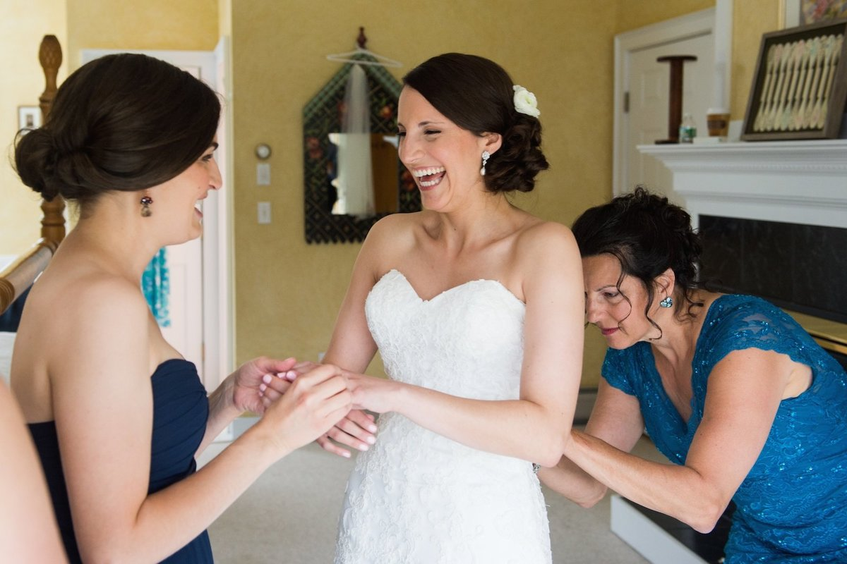 bride getting ready for her wedding and is super happy