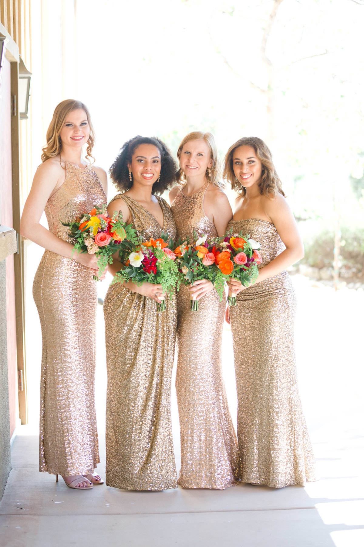bridal party portrait in rose gold bridesmaids dresses