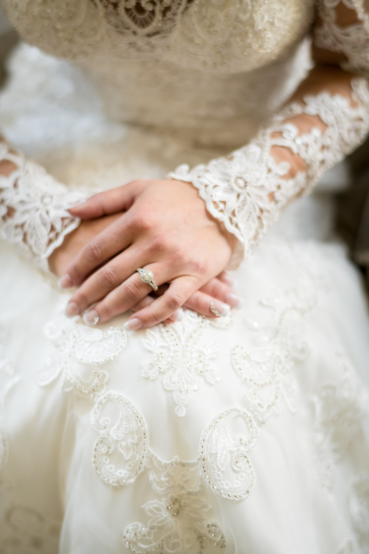 bride's hands and her wedding ring