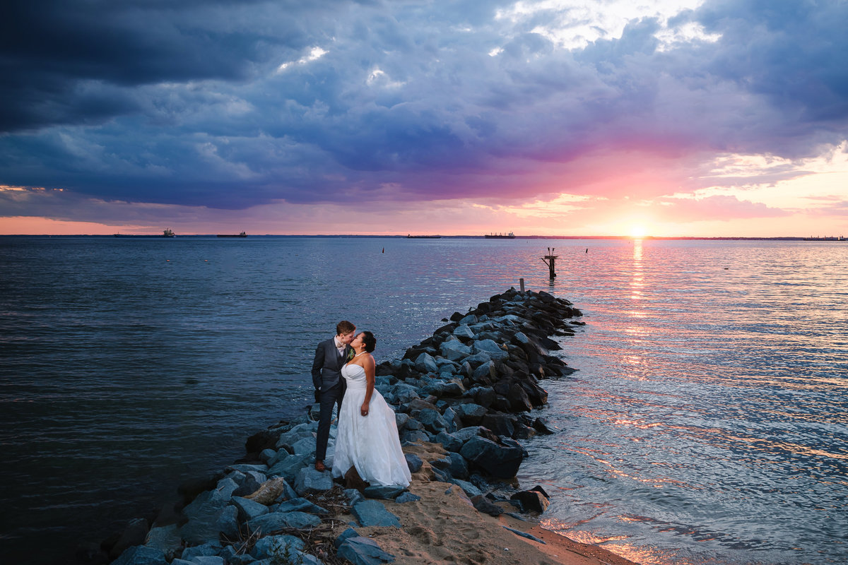 Eastern shore silver swan bayside LGBT wedding couple on rocks at sunset
