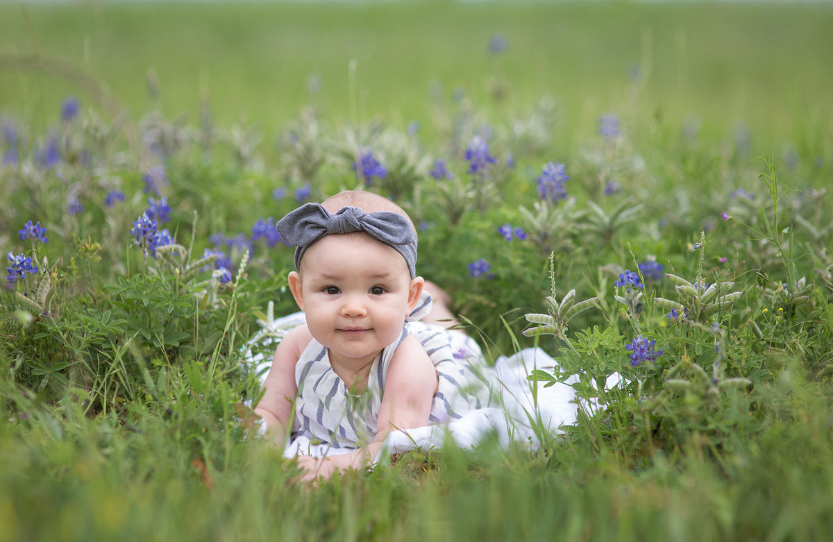 baby girl in blue bonnets