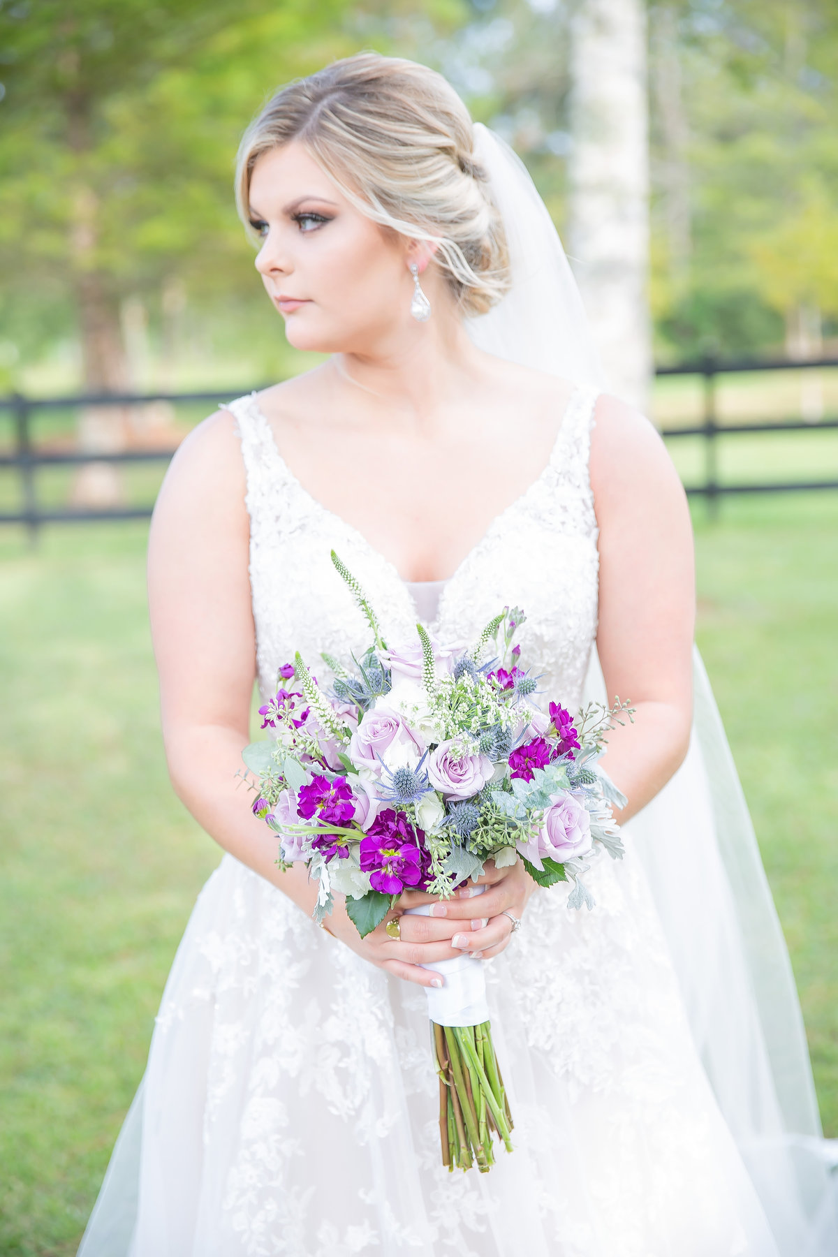 Bride holding bouquet at Acorn Lane Farms in Lucedale MS