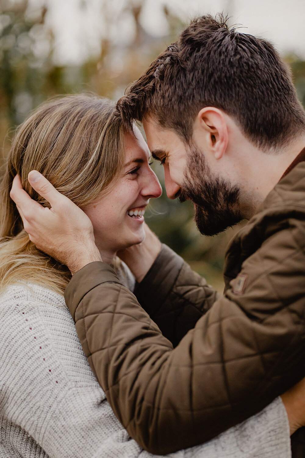 A newly engaged couple look at each other lovingly during a fall engagement session in New Jersey.
