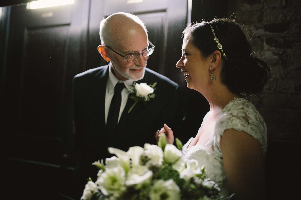 Bride talks to father before her wedding ceremony at Sanctuary on Penn in downtown indianapolis
