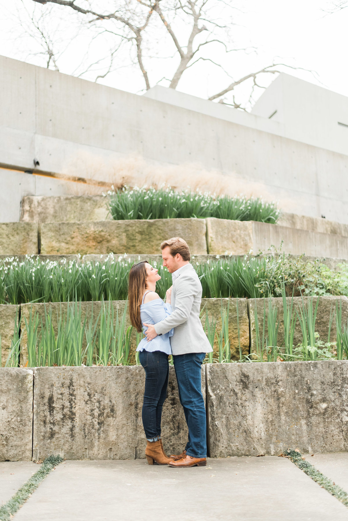 engagement photos couple in concrete garden