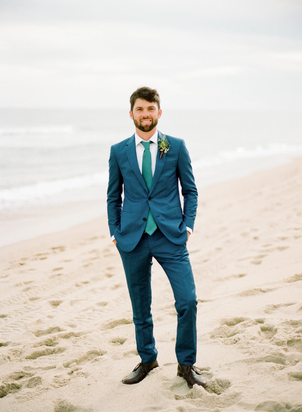 groom on beach nantucket wedding