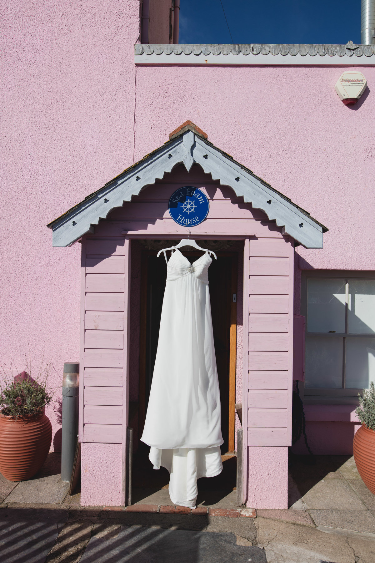 seaside wedding dress hanging up