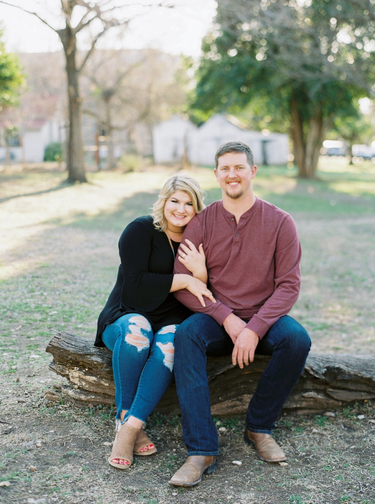 Film Engagement Session in Gruene, Texas. Bride wearing black top and distressed ripped jeans top, groom is wearing a burgundy long sleeve top and jeans.