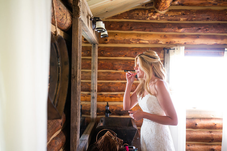 Strawberry-Creek-Ranch-Wedding-Ashley-McKenzie-Photography-Small-Wildflower-Outdoor-Wedding-Bride-putting-on-makeup