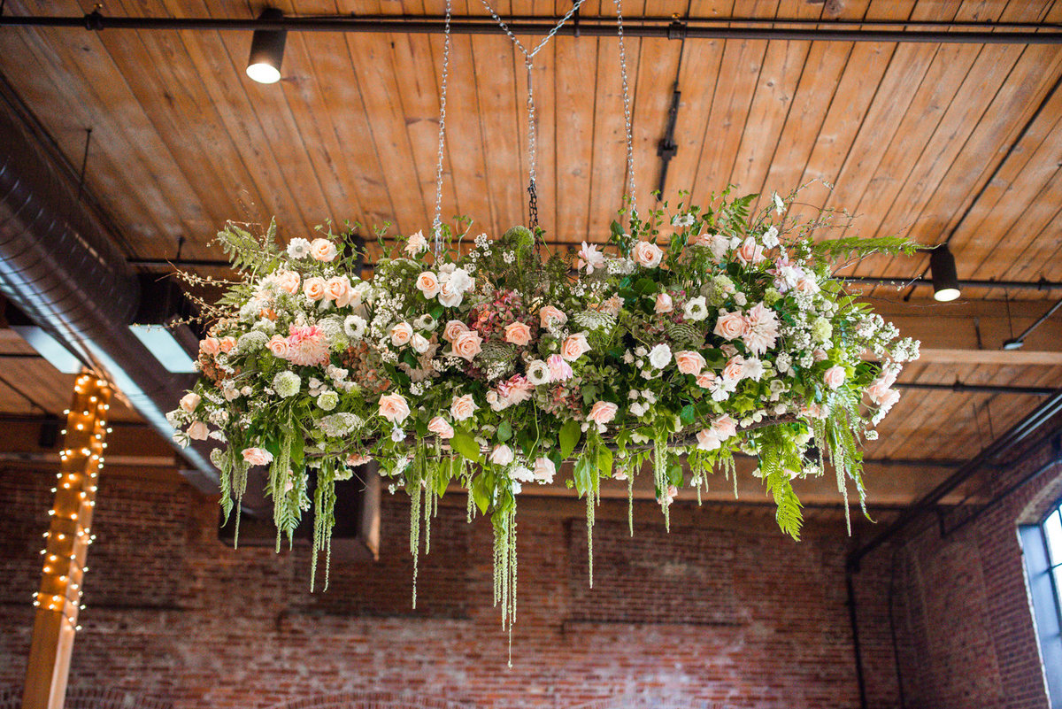 amazing floral chandelier with roses and greenery